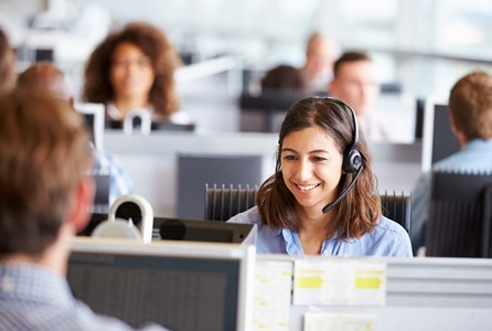 Customer contact centres - contact centre operative assisting on a call