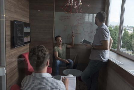 Huddle rooms - Employees using a Huddle Room to collaborate