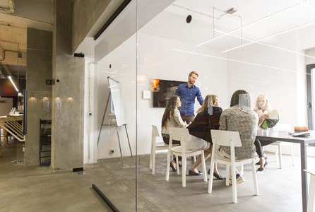 Modern meeting rooms - A group using a meeting room to collaborate