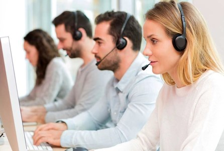 Customer contact centres - multiple contact centre operative assisting on a call